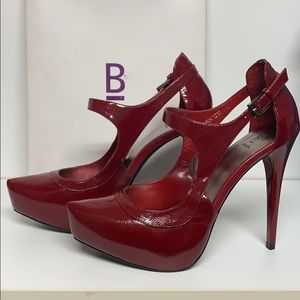 Platform heels by Bakers in Carson red, leather